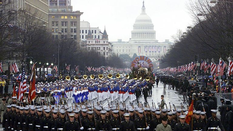 The 2001 inaugural parade down Pennsylvania Avenue after George W Bush was sworn in as the 43rd President of the United States