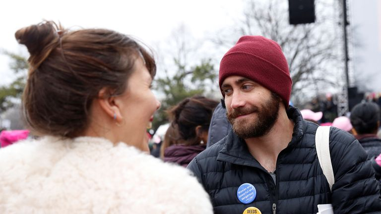 Actor Jake Gyllenhaal smiles with his sister Maggie at the Women's march against Trump
