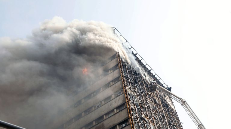 Firefighters battle a blaze at the Plasco building in Tehran before it collapsed