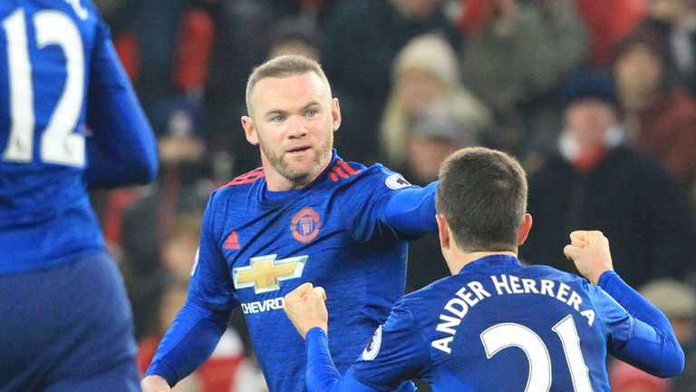 Manchester United's English striker Wayne Rooney (C) celebrates scoring the equalising goal for 1-1 and his 250th goal for Manchester United making him the club's all-time record scorer during the English Premier League football match between Stoke City and Manchester United at the Bet365 Stadium in Stoke-on-Trent, central England on January 21, 2017. / AFP / Lindsey PARNABY / RESTRICTED TO EDITORIAL USE. No use with unauthorized audio, video, data, fixture lists, club/league logos or 'live' ser