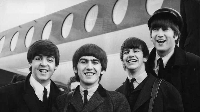 The Beatles at London airport after a trip to Paris