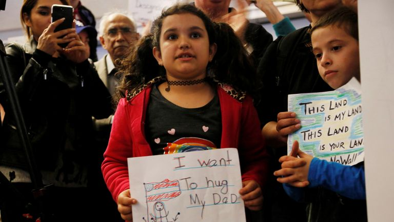 Teija age 7, her father is stuck in Iran due to the travel ban, holding a sign during protest against the travel ban imposed by U.S. President Donald Trump's executive order, at Los Angeles International Airport