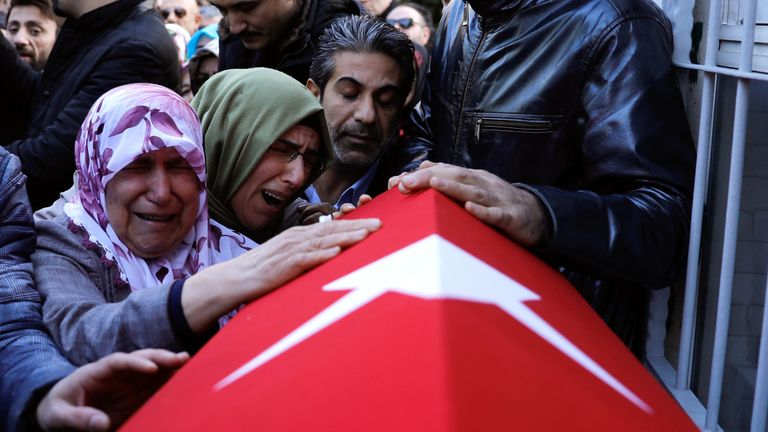 Relatives attend the funeral of one of the 39 victims of the massacre