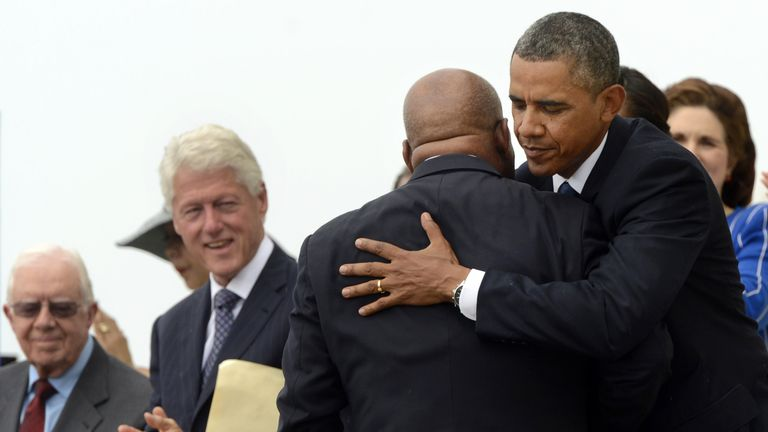Jimmy Carter and Bill Clinton look on as President Obama greets John Lewis on the 50th anniversary of the Dr King's 'I have a dream' speech