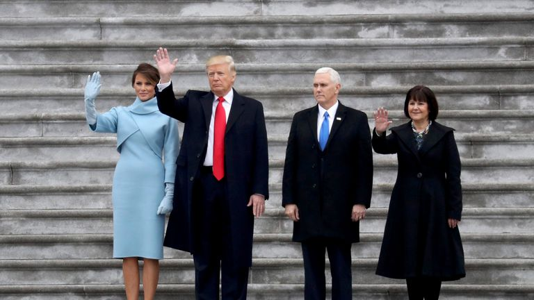 First Lady Melania Trump, President Donald Trump, Vice President Mike Pence and Karen Pence wave goodbye to the Obamas