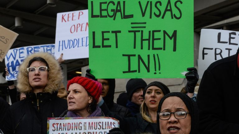 Some demonstrators were furious that legal, permanent US residents were unable to fly home