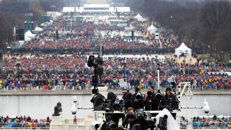 Spectators wait for the inauguration ceremonies