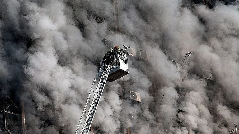Firefighters battle a fire at the Plasco building in Tehran