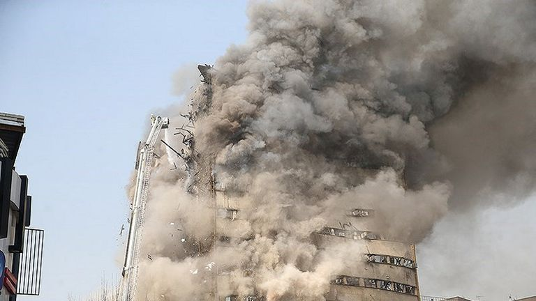 Smoke rises from the Plasco building in Tehran before it collapsed
