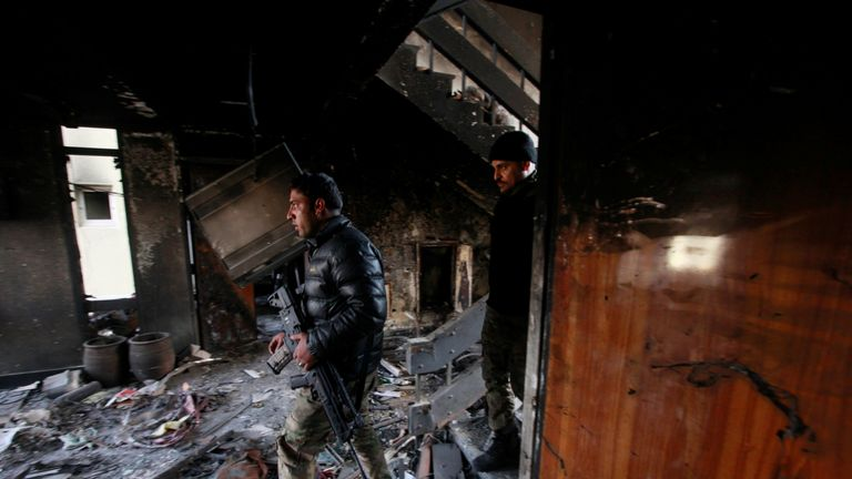 Members of the Iraqi forces inspect a hospital damaged by clashes during a battle between Iraqi forces and Islamic State militants in the Wahda district of eastern Mosul, Iraq, January 8, 2017
