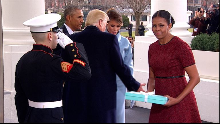 Michelle Obama receives a gift from Melania Trump