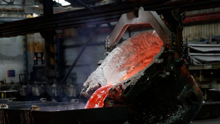 Molten aluminium is poured on the day of the completion of a 330 million pound deal to buy Britain's last remaining Aluminium smelter in Fort William Lochaber Scotland, Britain December 19, 2016.