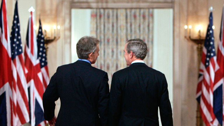 U.S. President George W. Bush and British Prime Minister Tony Blair  after speaking to reporters about Iraq in Washington May 25, 2006