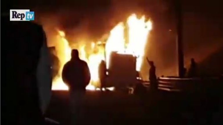 The bus crashed into barriers and burst into flames