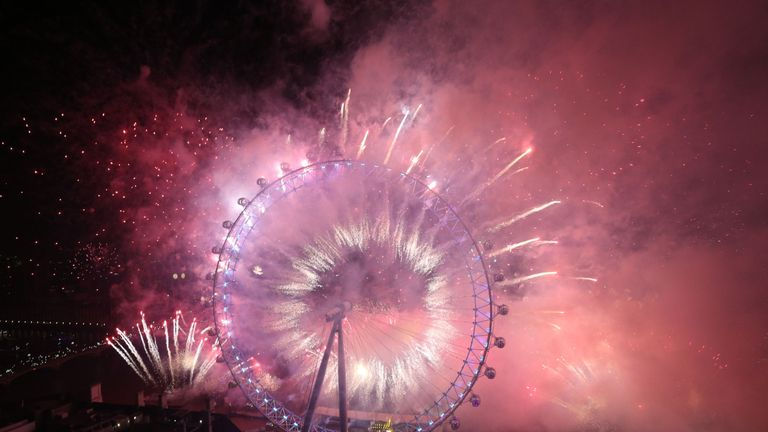 Fireworks light up the sky over the London Eye in central London