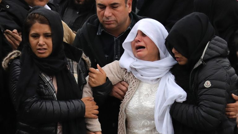 Mohammed Yassar Yaqub's mother is comforted as she leaves the mosque following her son's funeral