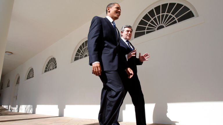 Barack Obama and Gordon Brown walk through the Colonnade at the White House in Washington, 2009