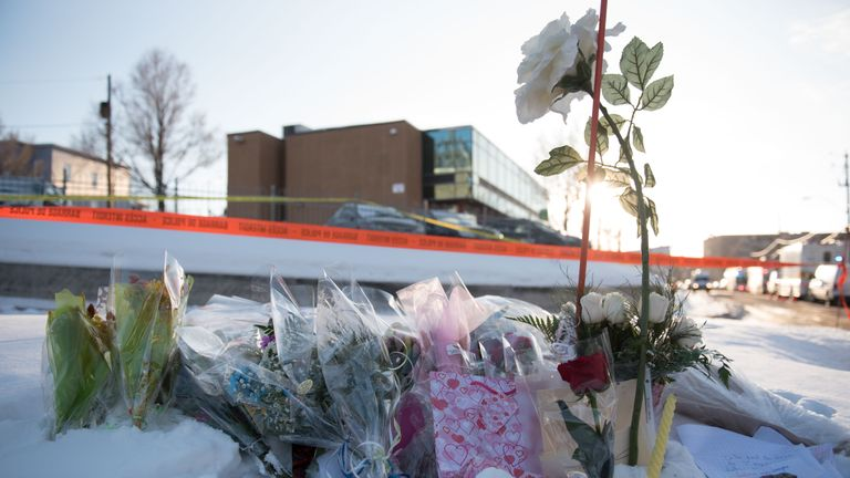 Flowers at a makeshift memorial near the Islamic Cultural Center in Quebec City, Canada on January 30, 2017