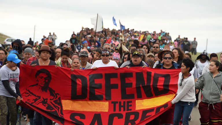 Native Americans protest about a sacred site disturbed by bulldozers building the pipeline