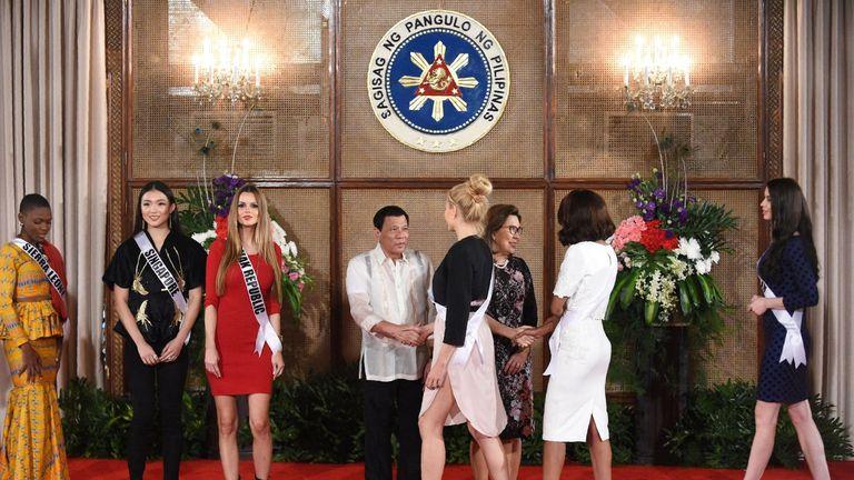 Miss Universe contestants pose for photos with Philippine President Rodrigo Duterte