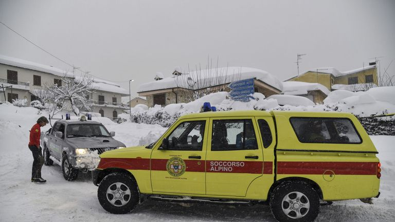 Emergency vehicles in the region hit by more quakes amid the snow