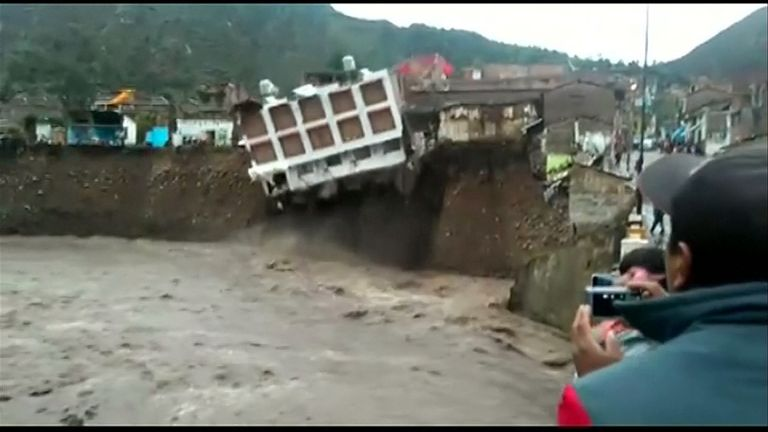 A hotel collapses into a river in Peru