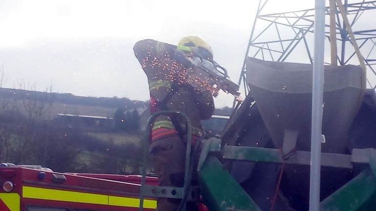 Rescue crews used cutting equipment to reach the man