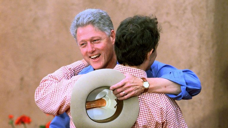 Bill Clinton hugs Tony Blair upon his arrival at the Denver Summit of the Eight. Blair obliged Clinton's request that all the leaders wear cowboy boots and casual wear to the dinner