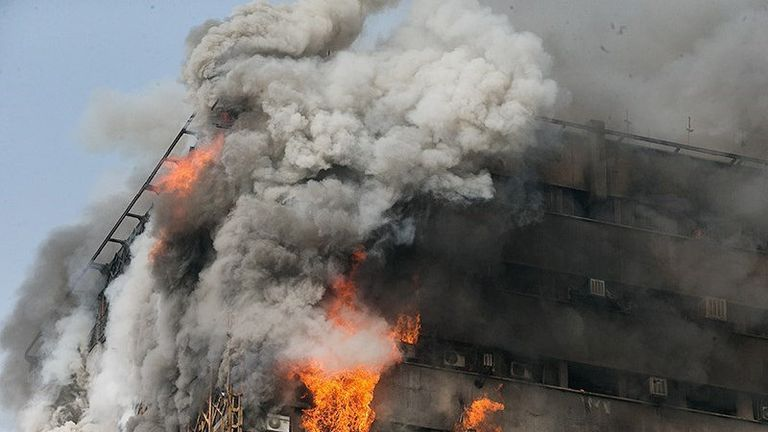 Flames engulf the Plasco building in Tehran