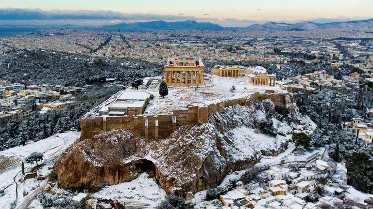 A rare snowfall in Greece covers the Parthenon
