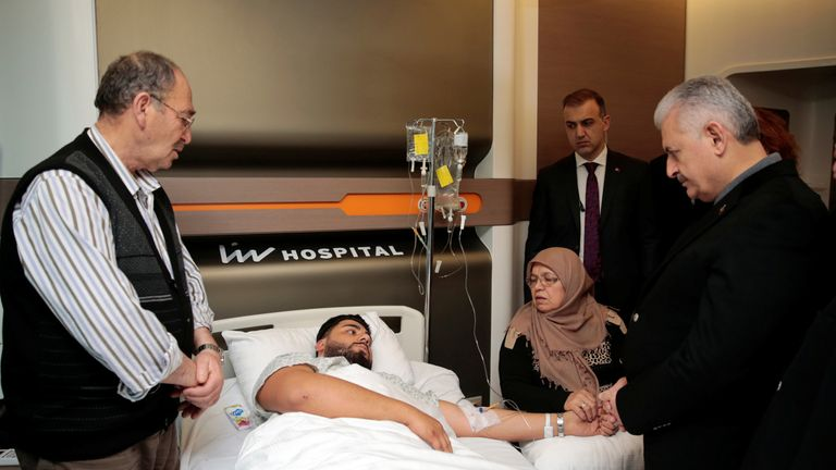Turkey's Prime Minister Binali Yildirim (R) visits survivor of nightclub attack