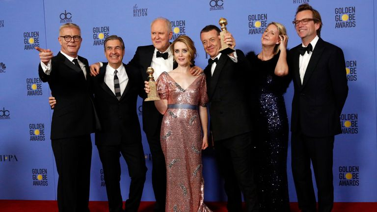 "The cast and crew of ""The Crown"" pose together after winning the award for Best Television Series - Drama as star Claire Foy holds her award for Best Performance by an Actress In A Television Series - Drama during the 74th Annual Golden Globe Awards in Beverly Hills, California, U.S., January 8, 2017"