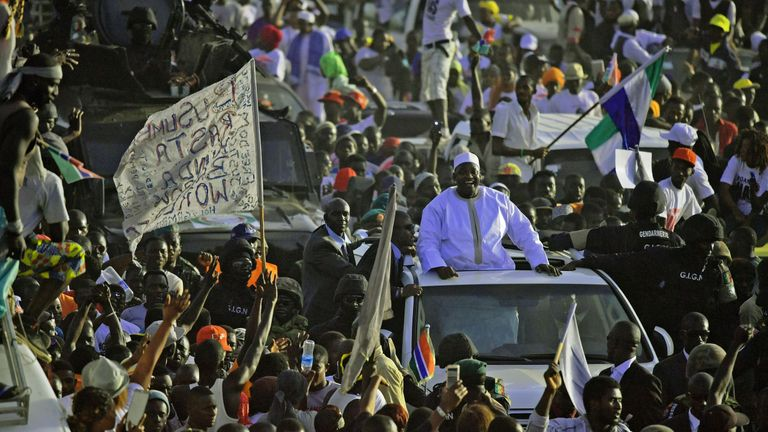 Adama Barrow is cheered by crowds as he returns to The Gambia