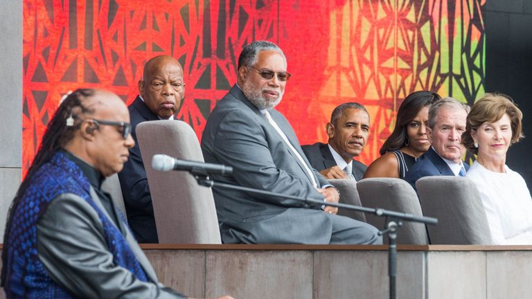 John Lewis watched Stevie Wonder preform at the opening of a museum of African American history as Presidents Obama and Bush look on
