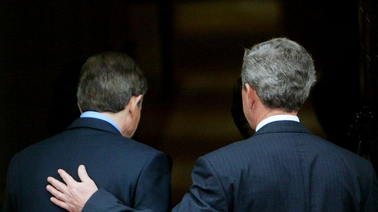 George W. Bush puts his hand on the back of Tony Blair as they enter 10 Downing Street, 2003