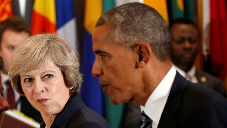 Theresa May looks over toward Barack Obama during the luncheon at the United Nations General Assembly in New York, 2016