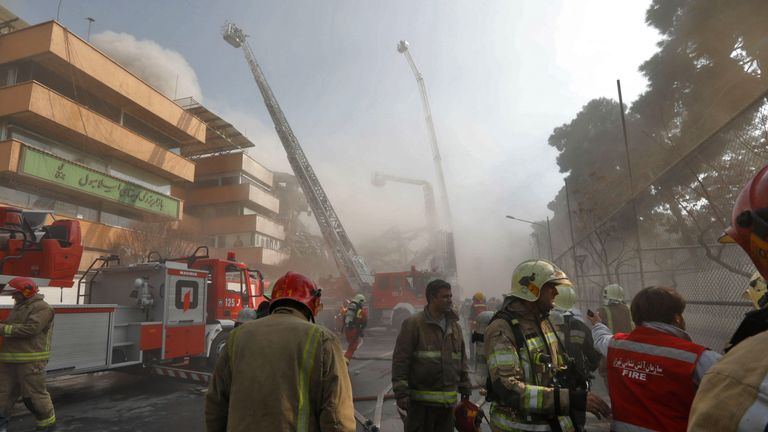 Firefighters at the scene of a building collapse in Tehran