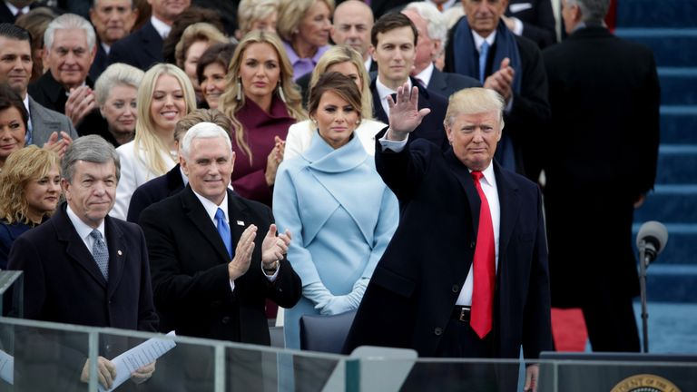 President Elect Donald Trump waves to spectators