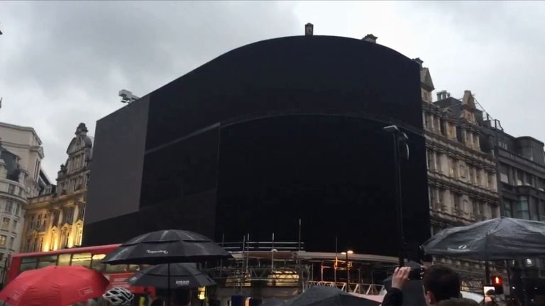 Billboards in London's Piccadilly Circus are switched off, pending replacement