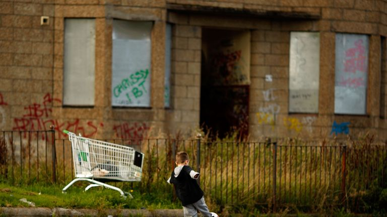 A young boy plays football in the street, September 30, 2008 in the Govan area of Glasgow, Scotland