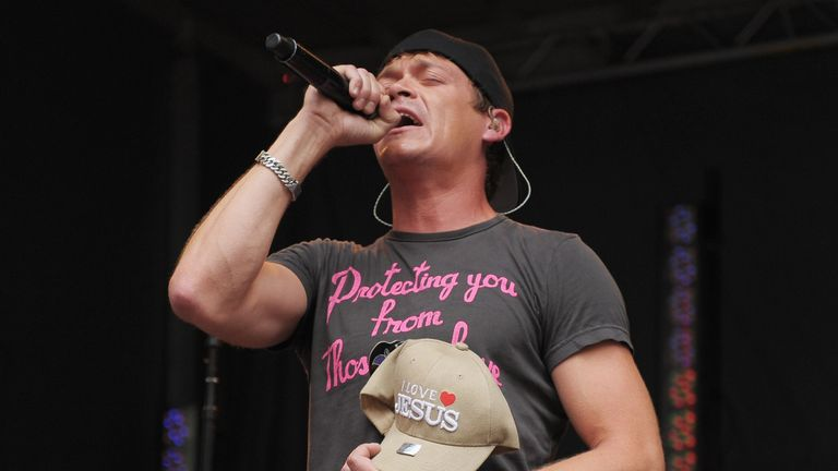 NEW YORK, NY - JULY 29: Vocalist Brad Arnold of 3 Doors Down holds a fan's 'I Love Jesus' hat