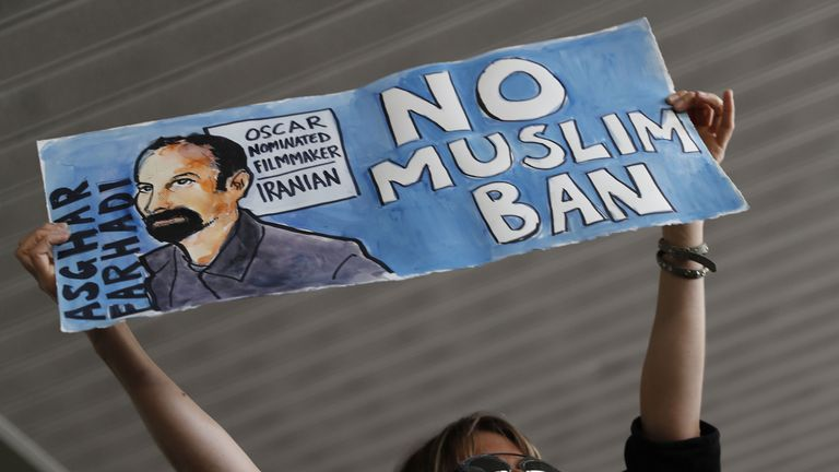 A woman holds a sign during a rally against a ban on Muslim immigration at San Francisco International Airport on January 28, 2017 in San Francisco, California. President Donald Trump signed an executive order Friday that suspends entry of all refugees for 120 days, indefinitely suspends the entries of all Syrian refugees, as well as barring entries from seven predominantly Muslim countries from entering for 90 days. (Photo by Stephen Lam/Getty Images)