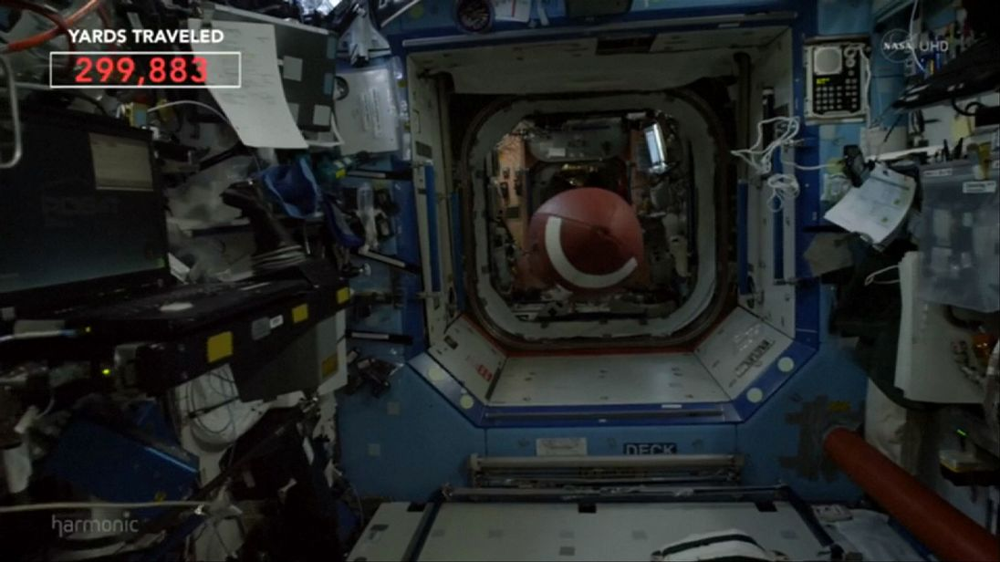 Astronauts play American Football in space