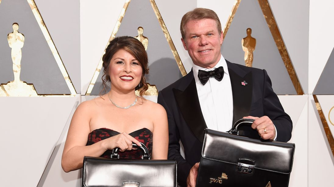 Winning envelope keepers Martha Ruiz and Brian Cullinan with the famed suitcases