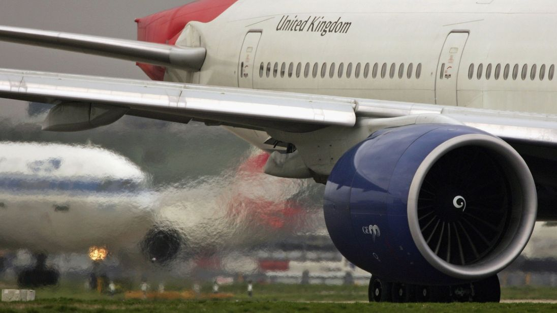 A jet engine powers a plane at Heathrow