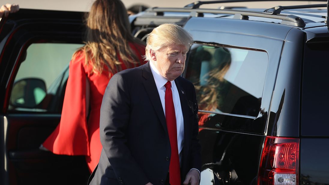 US President Donald Trump arrives aboard Air Force One at Palm Beach