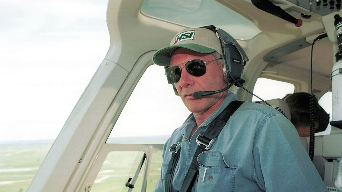 Actor Harrison Ford flies his helicopter July 10, 2001 near Jackson, Wy. Ford Located And Rescued Missing 13-Year-Old Boy Scout Cody Clawson. (Photo By Getty Images)