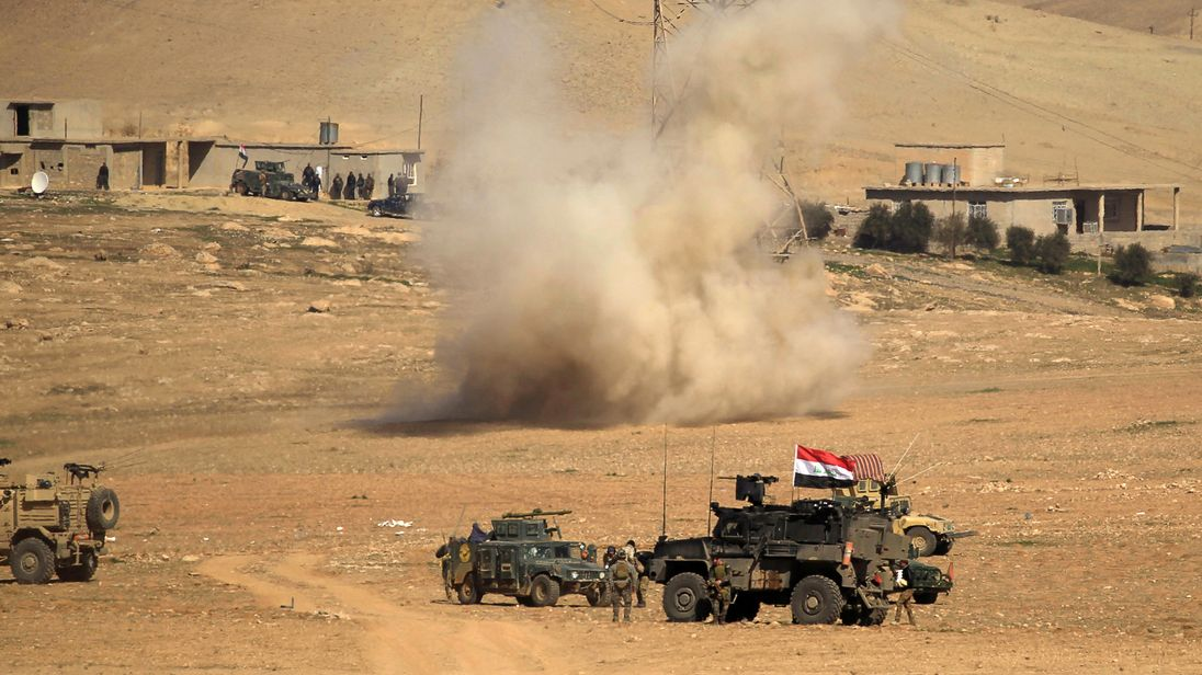 A rocket lands in the middle of Iraqi rapid response forces as fighting continued against IS in the push for Mosul