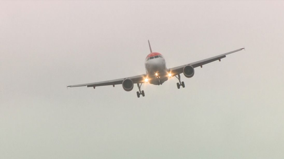 A plane wobbles as it comes in to land at Manchester Airport during Storm Doris