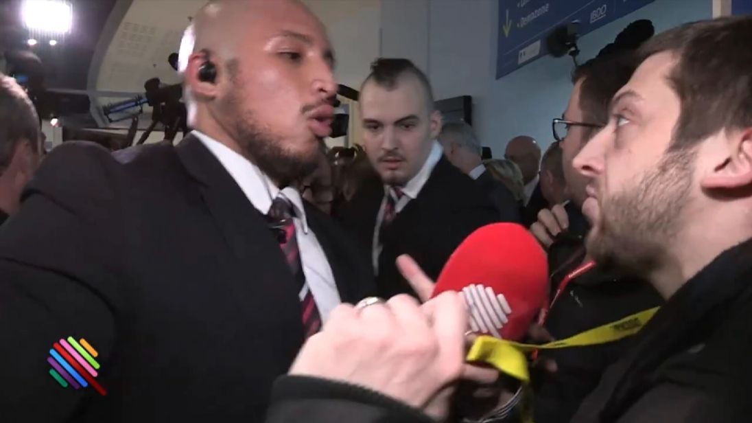 A reporter hustled away after trying to question Marine  Le Pen